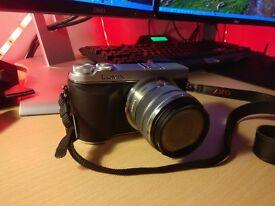Panasonic GX7 Digital Camera, original packaging and accessories, like new.