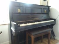 Upright Waldeck piano, quite elderly but still playable. It's heavy, if you can collect, it's free.