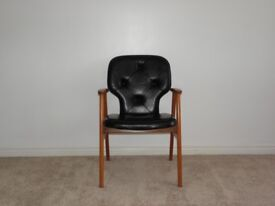 Black leather Danish retro armchair from 1970's