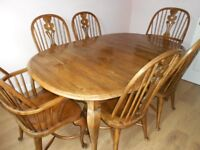 Cherry wood dining table and 6 chairs