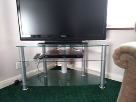 TV stand. Glass and silver.