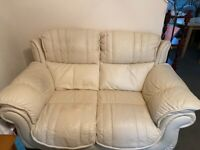 Pair of white / cream leather sofas from DFS