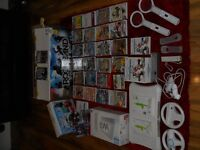 Nintendo wii console with rock band disney infinity wii fit mario kart super mario bros - 29 games