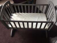 Grey rocking cradle and mattress