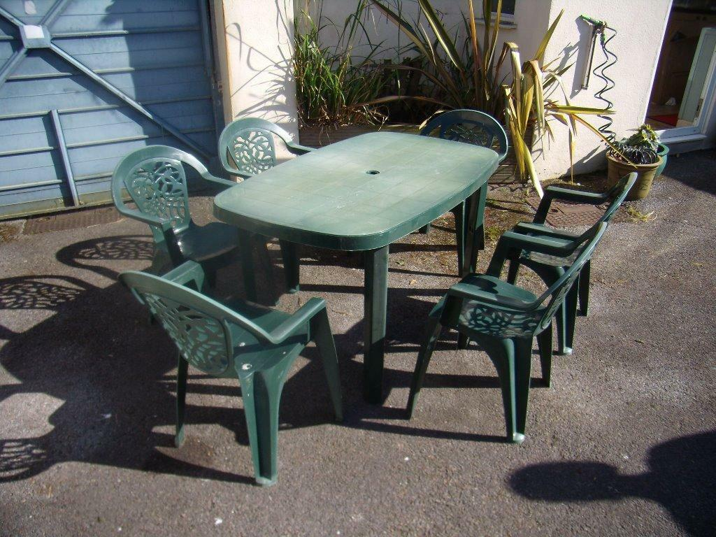 Green plastic garden table and six chairs in paignton for Plastic garden furniture