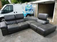 Black leather corner sofa with docking station