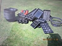 Quantity of new and used hanging baskets & pots