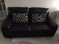 Two Black leather sofas, 1 x Black leather three seater sofa and 1 x Black leather two seater sofa