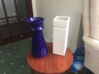 Three tall vases plus one smaller