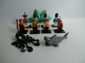 Lego 8 Pirate minifigures, shark and octopus.