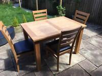 Solid wood dining table and 4 chairs by Julian Bowen