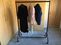 Metal clothes rail on castors, dismountable for easy storage and movement