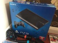 PlayStation 3 12GB + 15 games + 2 sing star microphones and USB converter + 2 controllers