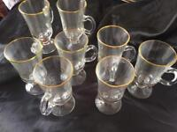 Collection of gold rimmed glasses