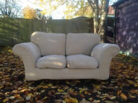 Matching 2 and 3 seater sofas. Cream velour washable covers wooden legs with brass runners