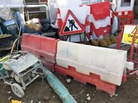 Traffic barriers for lane separation. 1.4 metres long. Can be water-filled for stability.