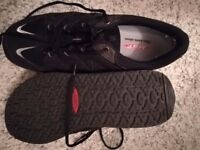 Mbt trainers one pair black one pair brown both size 10.5 will separate