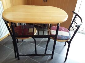 Kitchen table & 2 chairs. Good condition, very sturdy metal frame with wooden top.