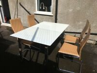 white dining table and coffee coloured faux leather dining chairs