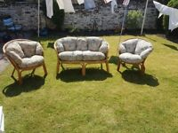 Three piece cane garden furniture set with detachable cushions great condition