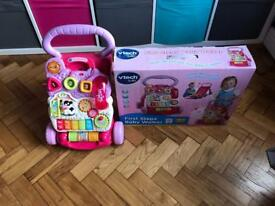 Pink Vtech baby walker with box
