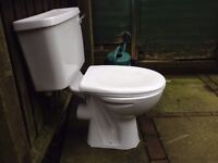 WC closed couple (full working) and wall basin with taps both white, in very good condition