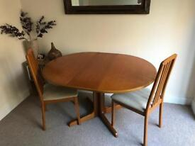 Adjustable pine dining table in great condition with two chairs