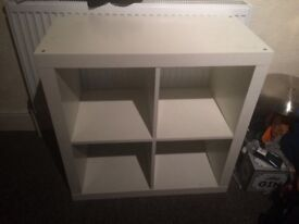 Two ikea storage / shelving units. One tall and one short