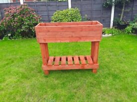 High standing garden planter box ceder red in colour very well made