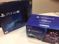 NEW and UNUSED: PS4 Pro 1TB black + VR headset with VR Worlds