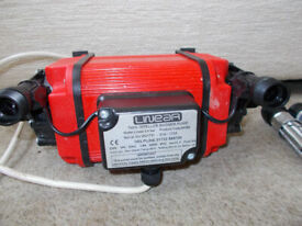 Twin entry shower pump