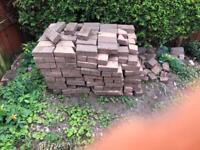 Reclaimed paving bricks.