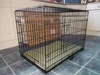 Large Dog Crate used twice in original box with unused padded, plush crate mat 91L X 57W X 64H