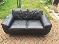 X2 two seater black leather sofas