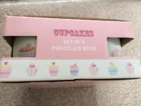 Set of four cupcake mugs brand-new