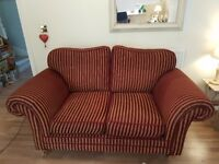 Windsor 2 seat sofa in Burgundy and Gold stripe. Wood legs with brass castor. Excellent condition