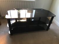 Black glass tv stand. Great condition. Quick sale