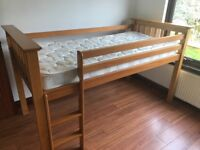 Kids cabin bed with mattress.