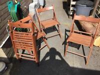 Set of four folding wooden garden chairs