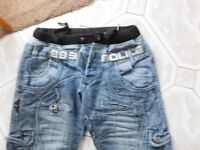 DESIGNER JEANS POLICE 883 WAIST SIZE APPROX 30