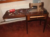Electric Singer sewing machine in original table with footcontrol