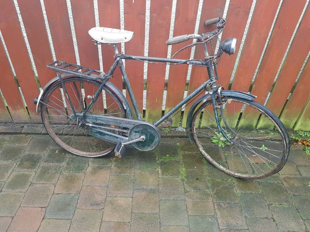 Vintage green raleigh bike with brooks leather bike saddle