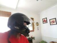 MOTORBIKE HELMET. Black, Full face, hardly been used. 56cm head size.