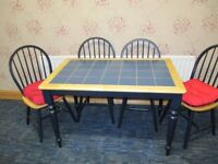 Kitchen table with tiled centre and 4 chairs