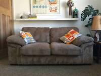 Mushroom coloured 2 seater corduroy effect sofa