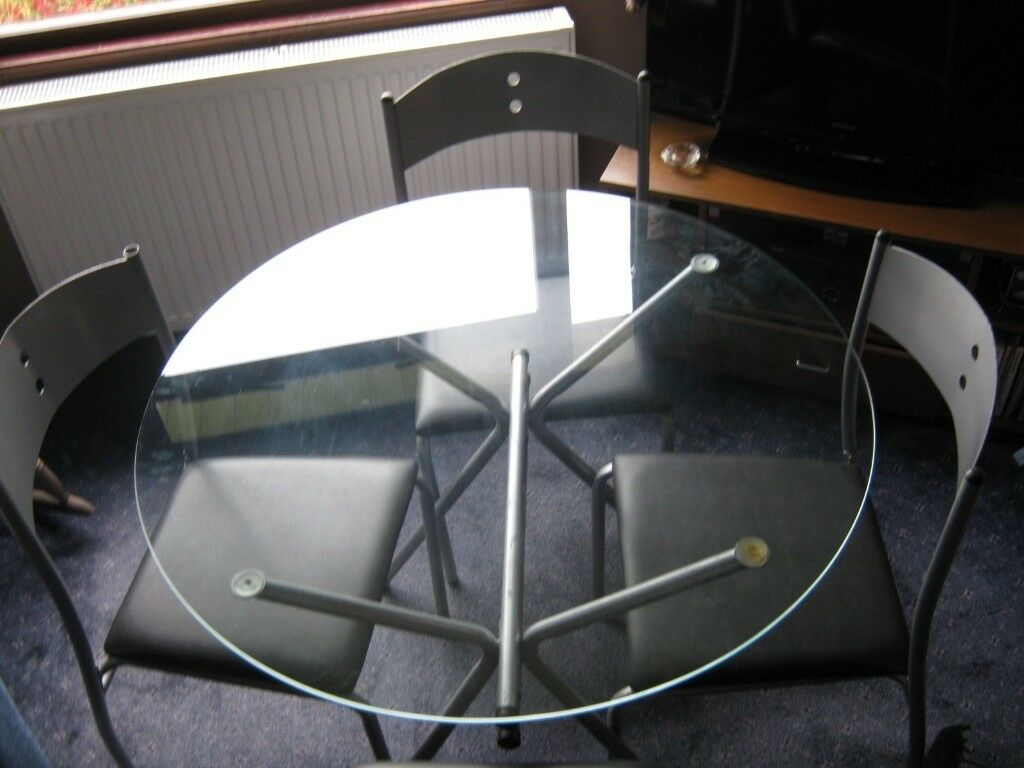 Circular glass topped dining table ,4 chairs