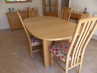 MODERN OAK DINING TABLE AND FOUR CHAIRS