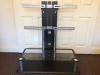 """TV STAND MOUNT STYLE WITH 2 GLASS SHELVES, SUITABLE FOR UPTO 50"""" INCH SIZE TELLY, GOOD CONDITION."""