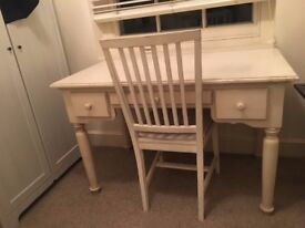 White wooden writing desk and chair