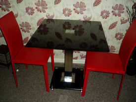 black glass dining table 2 red chairs